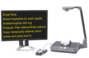 Eye-Pal Vision scanning and reading appliance showing magnified pill bottle instructions on a monitor.